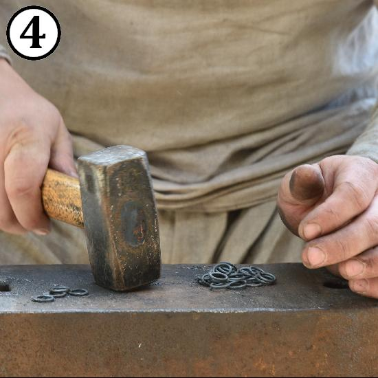 Striking rings by hammer to make them flat for making riveted chainmail rings.